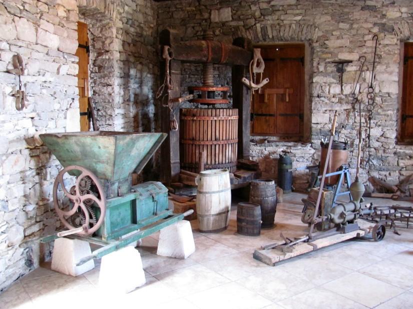 Traditional wine making tools inside the Toreta Winery